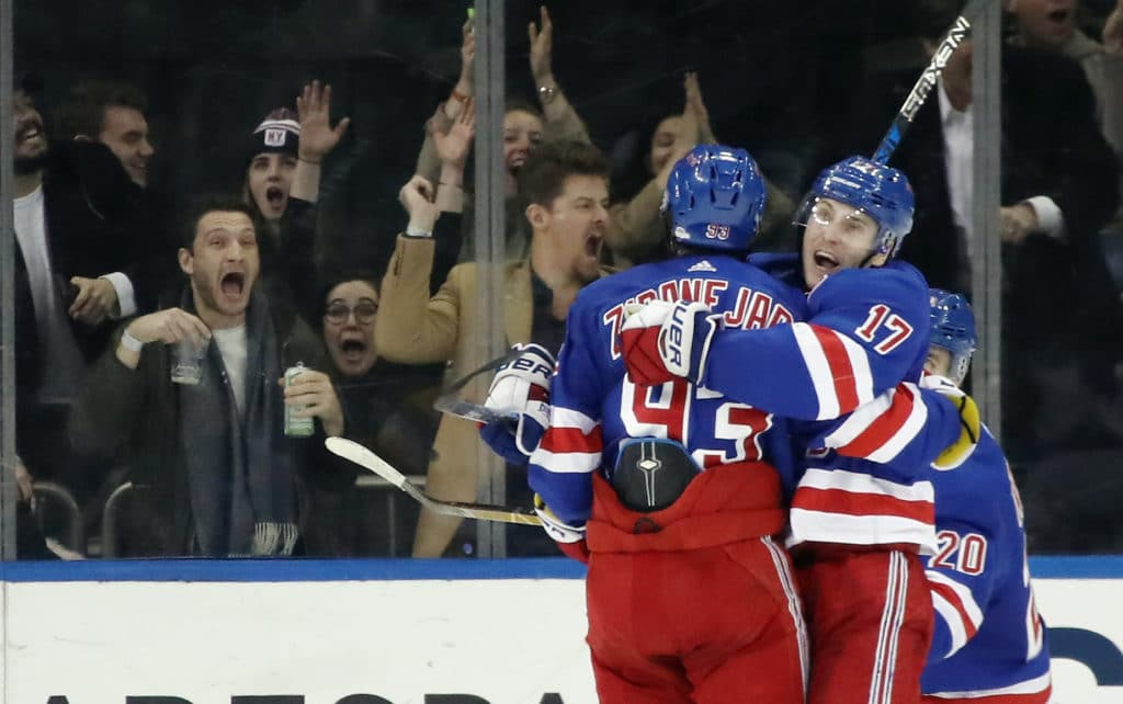 NEW YORK, NY - MARCH 14: Mika Zibanejad #93 and Jesper Fast #17 of the New York Rangers celebrate a goal against the Pittsburgh Penguins at Madison Square Garden on March 14, 2018 in New York City.  (Photo by Bruce Bennett/Getty Images)