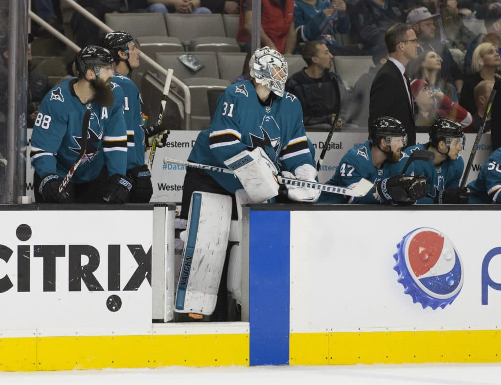 Mar 12, 2018; San Jose, CA, USA; San Jose Sharks goalie Martin Jones (31) is pulled from the net to provide an additional player on the ice against the Detroit Red Wings during the first period at SAP Center at San Jose. Mandatory Credit: Neville E. Guard-USA TODAY Sports