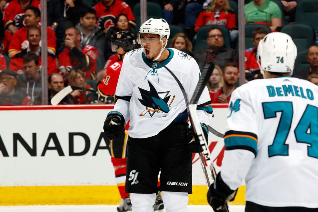 CALGARY, AB - MARCH 16: Evander Kane #9 of the San Jose Sharks celebrates a goal against the Calgary Flames during an NHL game on March 16, 2018 at the Scotiabank Saddledome in Calgary, Alberta, Canada. (Photo by Gerry Thomas/NHLI via Getty Images)