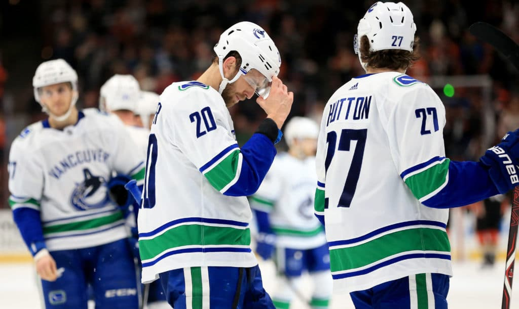 ANAHEIM, CA - MARCH 14:   Brandon Sutter #20 and Ben Hutton #27 of the Vancouver Canucks look on after a goal by Brandon Montour #26 of the Anaheim Ducks during the third  period of a game  at Honda Center on March 14, 2018 in Anaheim, California.  (Photo by Sean M. Haffey/Getty Images)