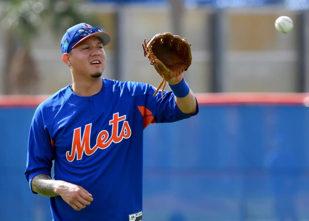 Feb 19, 2018; Port St. Lucie, FL, USA; New York Mets third baseman Wilmer Flores (4) during practice drills at First Data Field. Mandatory Credit: Steve Mitchell-USA TODAY Sports