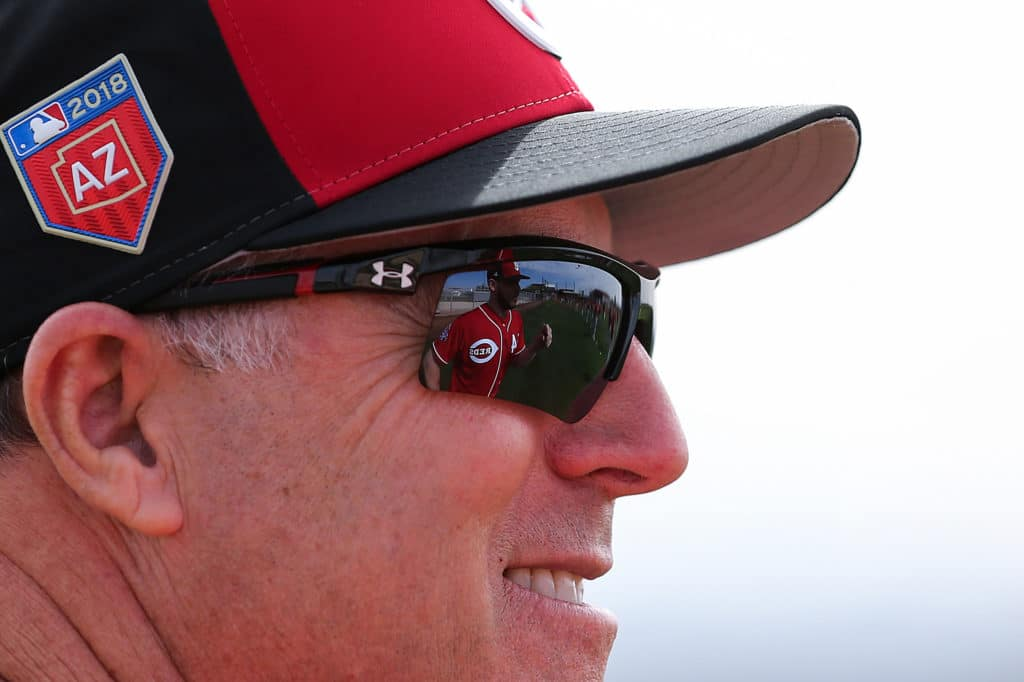 Feb 18, 2018; Goodyear, AZ, USA; Cincinnati Reds starting pitcher Rookie Davis (54) is reflected in the sunglasses of Reds manager Bryan Price (38) as they talk at the Cincinnati Reds spring training facility. Mandatory Credit: Kareem Elgazzar/The Cincinnati Enquirer Sentinel via USA TODAY NETWORK