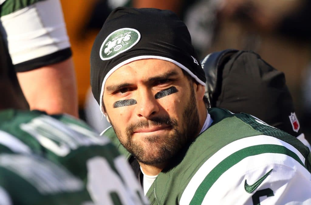 EAST RUTHERFORD, NJ - DECEMBER 23:  (NEW YORK DAILIES OUT)     Mark Sanchez #6 of the New York Jets looks on against the San Diego Chargers at MetLife Stadium on December 23, 2012 in East Rutherford, New Jersey. The Chragers defeated the Jets 27-17.  (Photo by Jim McIsaac/Getty Images)