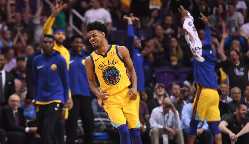 Mar 17, 2018; Phoenix, AZ, USA; Golden State Warriors guard Quinn Cook (4) reacts against the Phoenix Suns after making a three point shot during the second half at Talking Stick Resort Arena. Mandatory Credit: Joe Camporeale-USA TODAY Sports