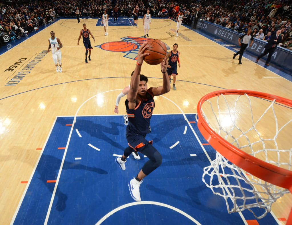NEW YORK,NY - MARCH 17 : Isaiah Hicks #4 of the New York Knicks goes up for the dunk against the Charlotte Hornets at Madison Square Garden on March 17, 2018 in New York,New York NOTE TO USER: User expressly acknowledges and agrees that, by downloading and/or using this Photograph, user is consenting to the terms and conditions of the Getty Images License Agreement. Mandatory Copyright Notice: Copyright 2018 NBAE (Photo by Jesse D. Garrabrant/NBAE via Getty Images)