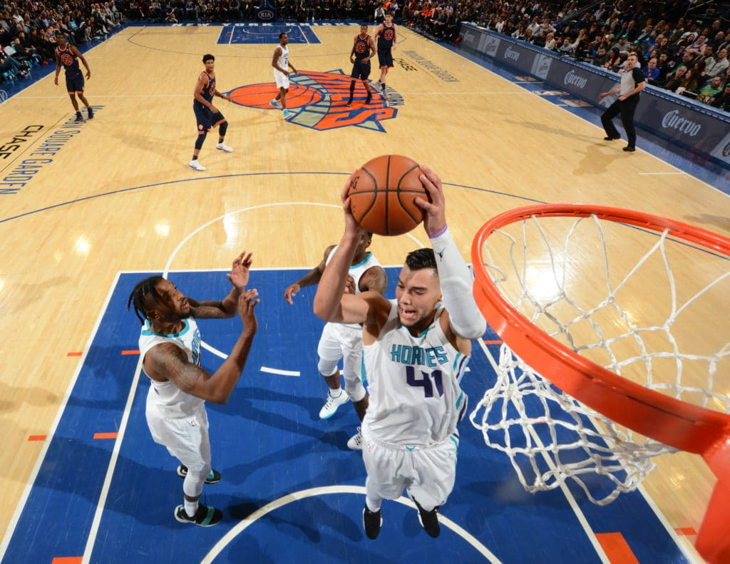NEW YORK,NY - MARCH 17 : Willy Hernangomez #41 of the Charlotte Hornets grabs the rebound against the New York Knicks at Madison Square Garden on March 17, 2018 in New York,New York NOTE TO USER: User expressly acknowledges and agrees that, by downloading and/or using this Photograph, user is consenting to the terms and conditions of the Getty Images License Agreement. Mandatory Copyright Notice: Copyright 2018 NBAE (Photo by Jesse D. Garrabrant/NBAE via Getty Images)