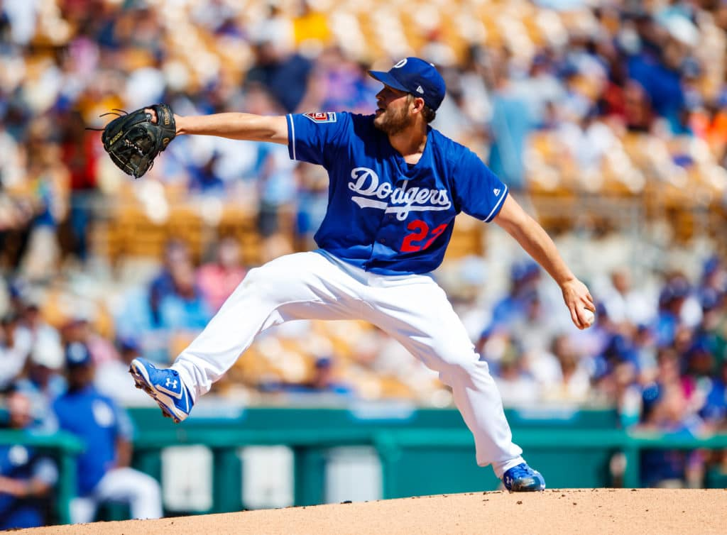 Mar 12, 2018; Glendale, AZ, USA; Los Angeles Dodgers pitcher Clayton Kershaw against the Milwaukee Brewers during a Spring Training game at Camelback Ranch. Mandatory Credit: Mark J. Rebilas-USA TODAY Sports
