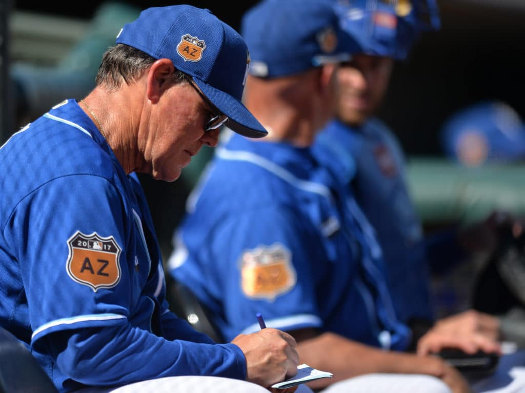 Mar 18, 2017; Surprise, AZ, USA; Kansas City Royals manager Ned Yost (3) writes on a lineup during the sixth inning against the Cleveland Indians at Surprise Stadium. Mandatory Credit: Jake Roth-USA TODAY Sports