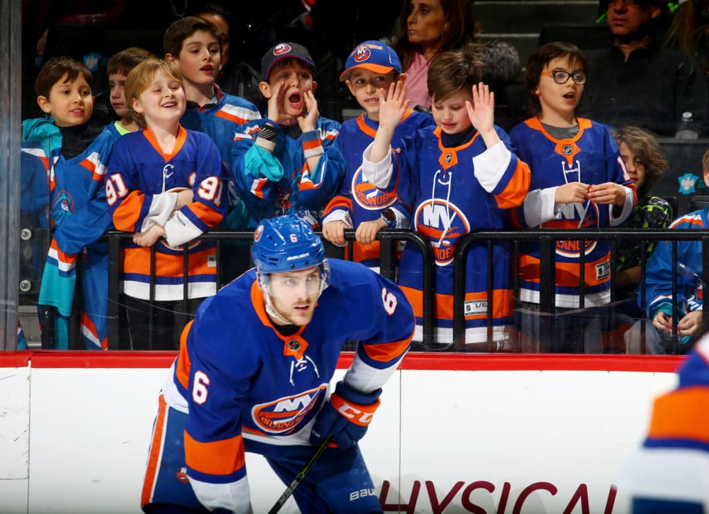 NEW YORK, NY - MARCH 18: A group of young fans look on during the third period against the Carolina Hurricanes as Ryan Pulock #6 lines up for a faceoff at Barclays Center on March 18, 2018 in New York City.  (Photo by Mike Stobe/NHLI via Getty Images)