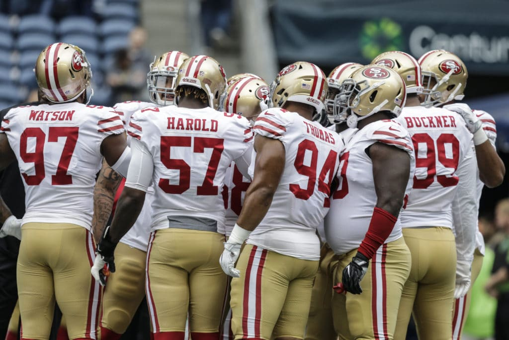 SEATTLE, WA - SEPTEMBER 17: Members of the defense including Dekoda Watson #97 of the San Francisco 49ers, Eli Harold #57 of the San Francisco 49ers, Solomon Thomas #94 of the San Francisco 49ers, Earl Mitchell #90 of the San Francisco 49ers and DeForest Buckner #99 of the San Francisco 49ers huddle before a game against the Seattle Seahawks at CenturyLink Field on September 17, 2017 in Seattle, Washington. The Seahawks won the game 12-9. (Photo by Stephen Brashear/Getty Images)