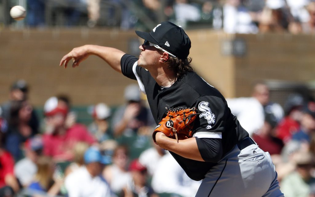 Chicago White Sox pitcher Carson Fulmer throws against the Arizona Diamondbacks during the first inning of a spring training baseball game Monday, March 19, 2018, in Scottsdale, Ariz. (AP Photo/Matt York)