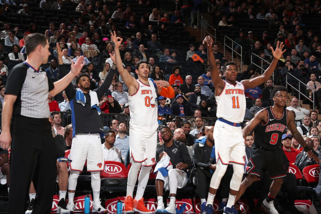 NEW YORK, NY - MARCH 19: Courtney Lee #5, Enes Kanter #00, and Frank Ntilikina #11 of the New York Knicks react to a play during the game against the Chicago Bulls on March 19, 2018 at Madison Square Garden in New York City, New York. NOTE TO USER: User expressly acknowledges and agrees that, by downloading and/or using this photograph, user is consenting to the terms and conditions of the Getty Images License Agreement. Mandatory Copyright Notice: Copyright 2018 NBAE (Photo by Nathaniel S. Butler/NBAE via Getty Images)
