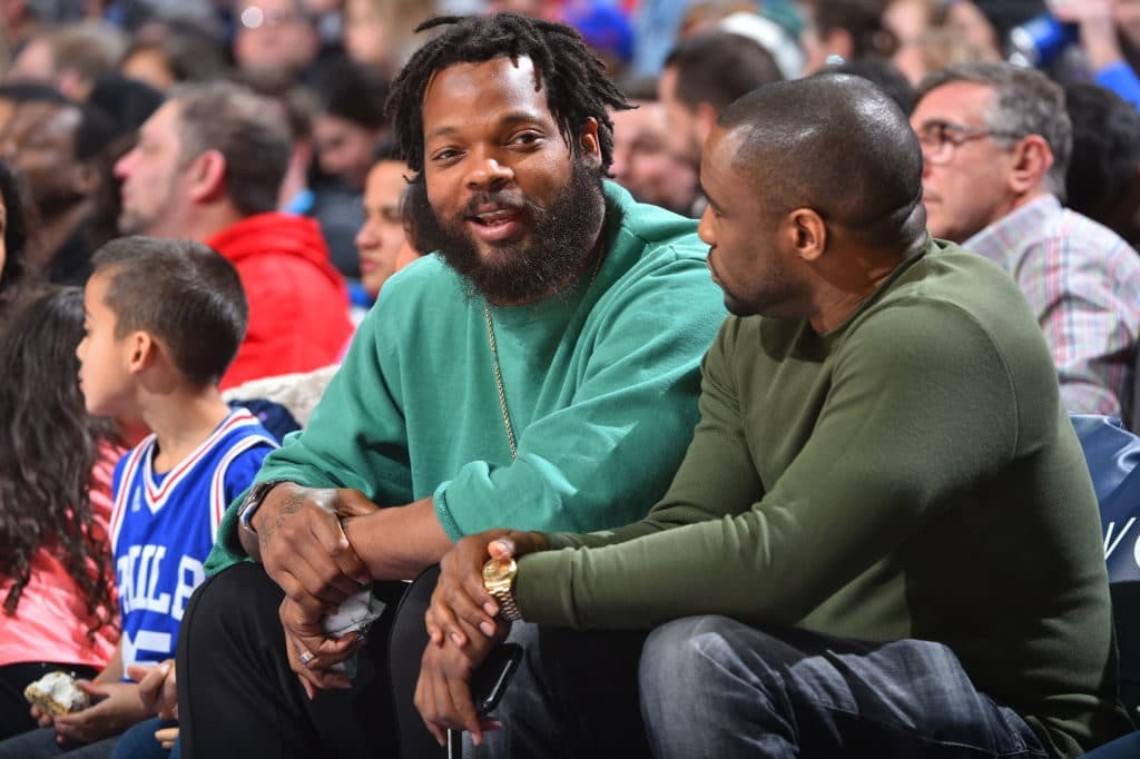 PHILADELPHIA,PA -  MARCH 19 : Michael Bennett  of the Philadelphia Eagles watches the 76ers against the Charlotte Hornets at Wells Fargo Center on March 19, 2018 in Philadelphia, Pennsylvania NOTE TO USER: User expressly acknowledges and agrees that, by downloading and/or using this Photograph, user is consenting to the terms and conditions of the Getty Images License Agreement. Mandatory Copyright Notice: Copyright 2018 NBAE (Photo by Jesse D. Garrabrant/NBAE via Getty Images)