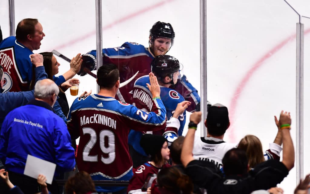 Mar 18, 2018; Denver, CO, USA; Colorado Avalanche center Nathan MacKinnon (29) celebrates his goal with left wing Gabriel Landeskog (92) in the third period against the Detroit Red Wings at the Pepsi Center. Mandatory Credit: Ron Chenoy-USA TODAY Sports