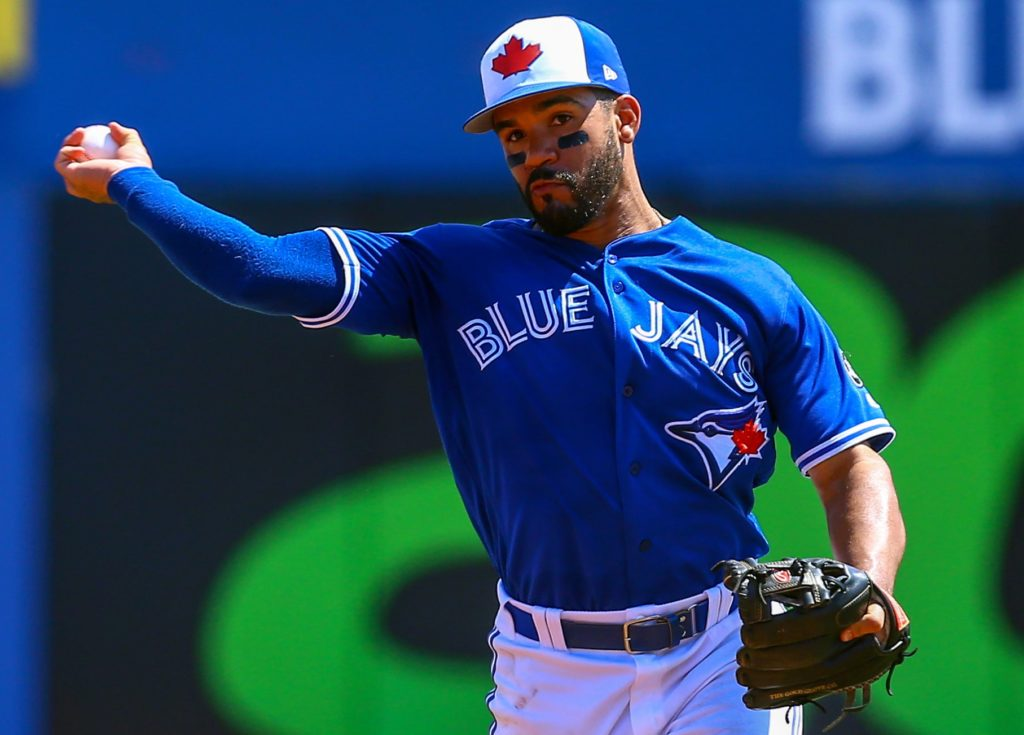 Mar 18, 2018; Dunedin, FL, USA; Toronto Blue Jays second baseman Devon Travis (29) throws to first for the out during the third inning of a Spring Training baseball game against the Pittsburgh Pirates at Dunedin Stadium. Mandatory Credit: Butch Dill-USA TODAY Sports