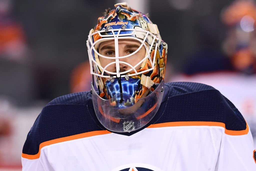 Mar 13, 2018; Calgary, Alberta, CAN; Edmonton Oilers goalie Cam Talbot (33) warms up against the Calgary Flames at Scotiabank Saddledome. Mandatory Credit: Candice Ward-USA TODAY Sports