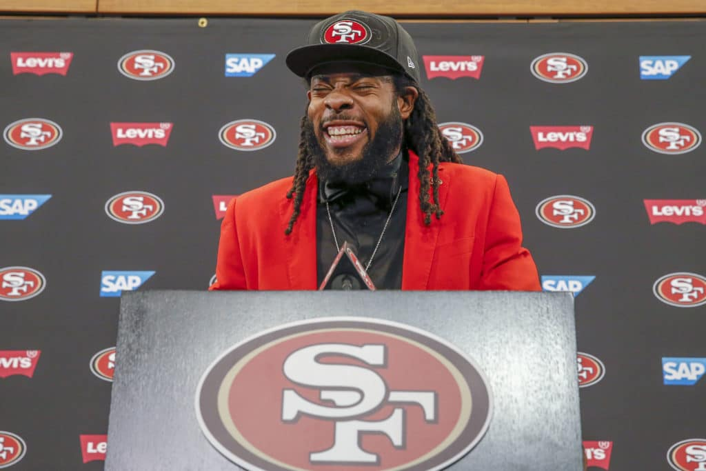 New San Francisco 49ers cornerback Richard Sherman laughs as he answers questions during an NFL football news conference in Santa Clara, Calif., Tuesday, March 20, 2018. Sherman agreed to a three-year deal with the 49ers. (AP Photo/Tony Avelar)