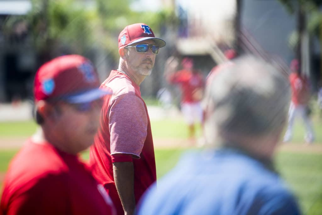Phillies first base coach Jose Flores observes from the sidelines as the Philidelphia Phillies gathered for their first full-team workout on Monday morning, February 19, 2018 at Spectrum Field in Clearwater, Florida.