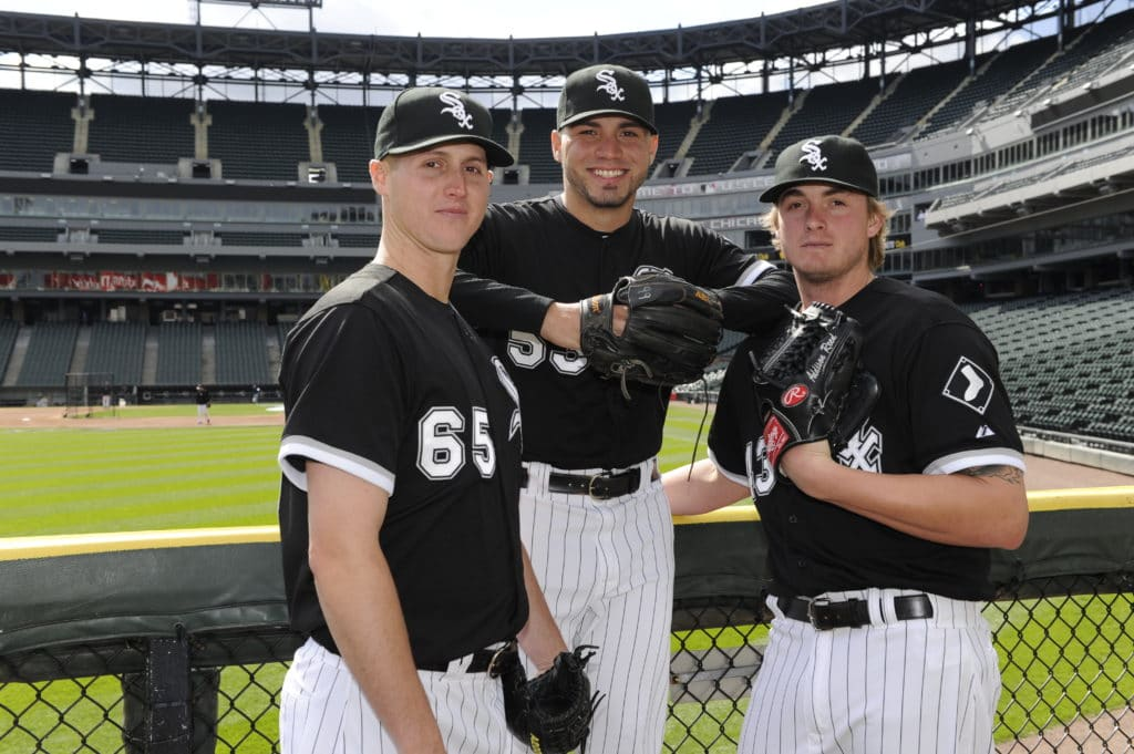 CHICAGO - APRIL 25:  Pitchers Nate Jones, Hector Santiago and Addison Reed (left to right) of the Chicago White Sox pose for a photo prior to the game against the Tampa Bay Rays on April 25, 2013 at U.S. Cellular Field in Chicago, Illinois.  (Photo by Ron Vesely/MLB Photos via Getty Images)