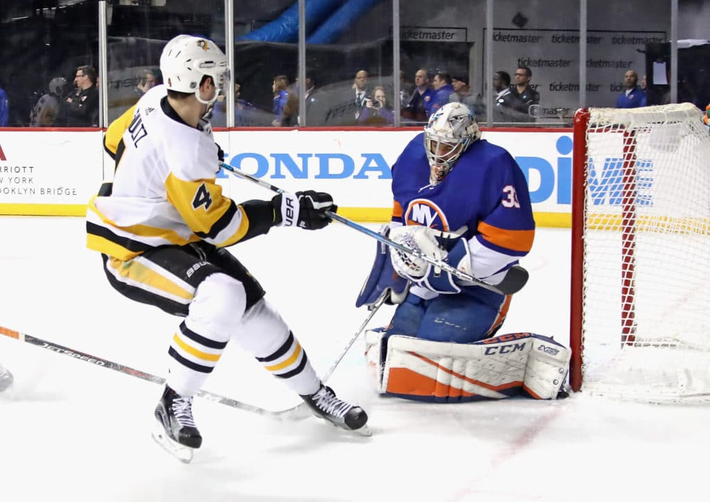 NEW YORK, NY - MARCH 20: Christopher Gibson #33 of the New York Islanders makes the first period save on Justin Schultz #4 of the Pittsburgh Penguins at the Barclays Center on March 20, 2018 in the Brooklyn borough of New York City.  (Photo by Bruce Bennett/Getty Images)