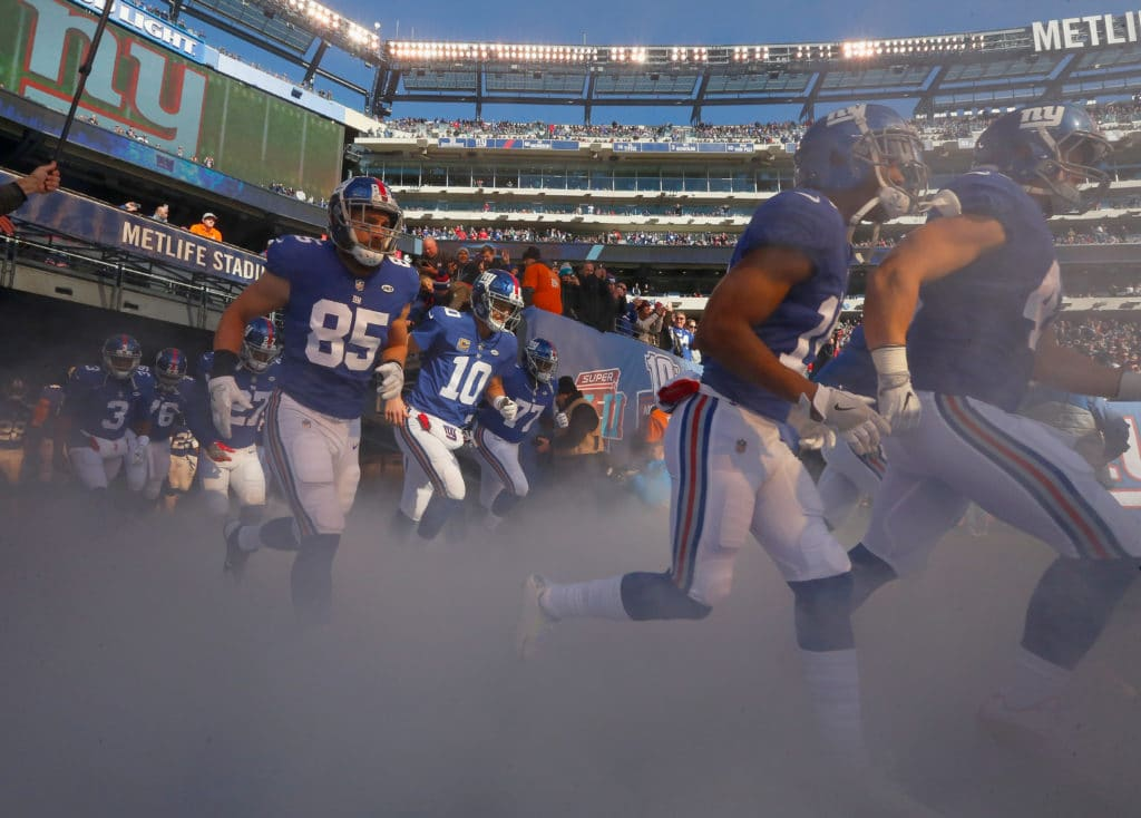 EAST RUTHERFORD, NJ - NOVEMBER 19:  (NEW YORK DAILIES OUT)   Eli Manning #10 of the New York Giants takes the field with his teammates for a game against the Kansas City Chiefs on November 19, 2017 at MetLife Stadium in East Rutherford, New Jersey. The Giants defeated the Chiefs 12-9 in overtime.  (Photo by Jim McIsaac/Getty Images)