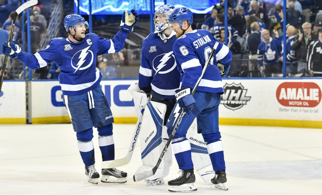 TAMPA, FL - MARCH 20: Tampa Bay Lightning center Steven Stamkos (91) joins Tampa Bay Lightning defender Anton Stralman (6) to congratulate Tampa Bay Lightning goalie Andrei Vasilevsky (88) after an NHL game between the Toronto Maple Leafs and the Tampa Bay Lightning on March 20, 2018, at Amalie Arena in Tampa, FL. The Lightning scored three goals in the third period to defeat the Maple Leafs 4-3. (Photo by Roy K. Miller/Icon Sportswire via Getty Images)