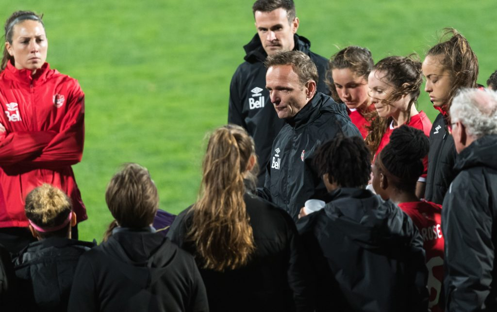 coach Kenneth Heiner-Møller of Canada women between his players and staff during the Algarve Cup 2018 match between Canada and Sweden at the Estadio Municipal da Bela Vista on February 28, 2018 in Parchal, Portugal(Photo by VI Images via Getty Images)