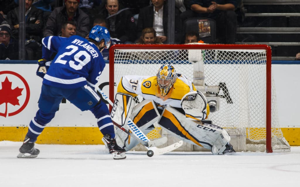 TORONTO, ON - FEBRUARY 7: William Nylander #29 of the Toronto Maple Leafs goes to the net against Pekka Rinne #35 of the Nashville Predators in the shootout at the Air Canada Centre on February 7, 2018 in Toronto, Ontario, Canada. (Photo by Mark Blinch/NHLI via Getty Images)
