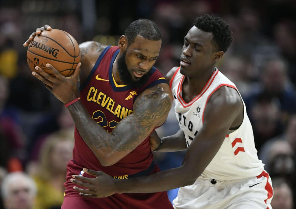 Mar 21, 2018; Cleveland, OH, USA; Toronto Raptors forward Pascal Siakam (43) defends Cleveland Cavaliers forward LeBron James (23) in the first quarter at Quicken Loans Arena. Mandatory Credit: David Richard-USA TODAY Sports