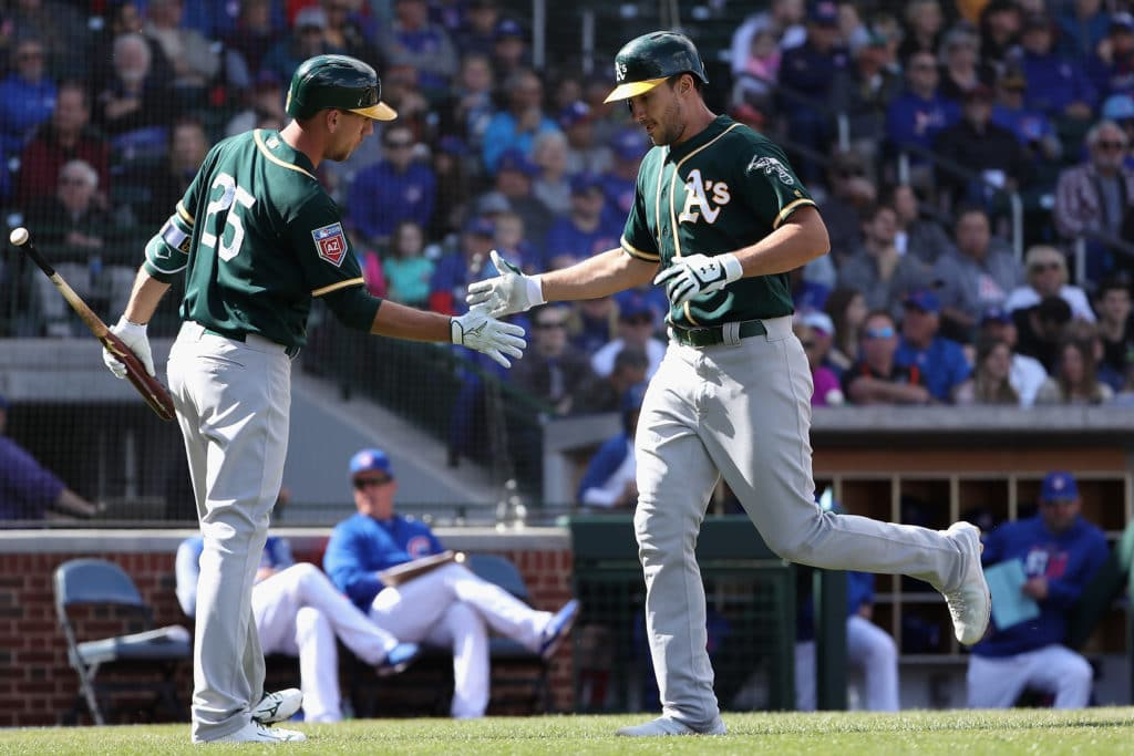 MESA, AZ - FEBRUARY 28:  Matt Olson #28 of the Oakland Athletics high fives Stephen Piscotty #25 of the Oakland Athletics after hitting a solo home run against the Chicago Cubs during the fourth inning of the spring training game at Sloan Park on February 28, 2018 in Mesa, Arizona.  (Photo by Christian Petersen/Getty Images)