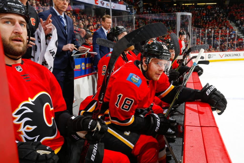 CALGARY, AB - MARCH 21: Matt Stajan #18 of the Calgary Flames sits on the bench in an NHL game on March 21, 2018 at the Scotiabank Saddledome in Calgary, Alberta, Canada. (Photo by Gerry Thomas/NHLI via Getty Images)
