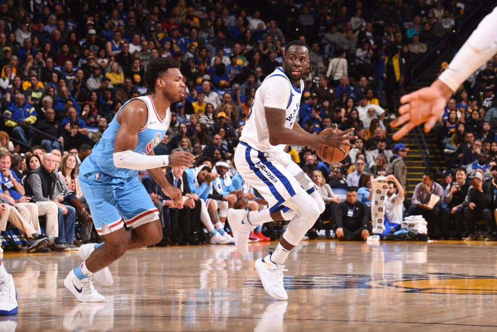 OAKLAND, CA - MARCH 16: Draymond Green #23 of the Golden State Warriors handles the ball during the game against the Sacramento Kings  on March 16, 2018 at ORACLE Arena in Oakland, California. NOTE TO USER: User expressly acknowledges and agrees that, by downloading and or using this photograph, user is consenting to the terms and conditions of Getty Images License Agreement. Mandatory Copyright Notice: Copyright 2018 NBAE (Photo by Noah Graham/NBAE via Getty Images)