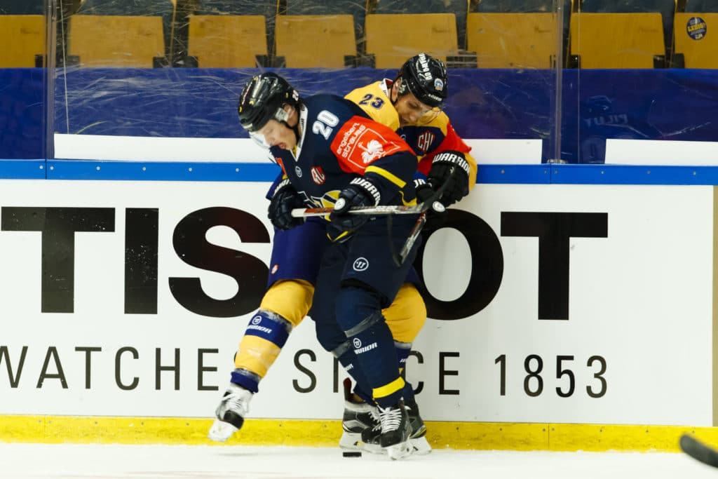 JONKOPING, SWEDEN - OCTOBER 04: Lauri Tukonen #23 of Lukko Rauma battling for the puck with Lawrence Pilut #20 of HV71 Jonkoping, during the Champions Hockey League Round of 32 match between HV71 Jonkoping and Lukko Rauma at Kinnarps Arena on October 4, 2016 in Jonkoping, Sweden. (Photo by Daniel Malmberg/HV71 Jonkoping/Champions Hockey League via Getty Images)