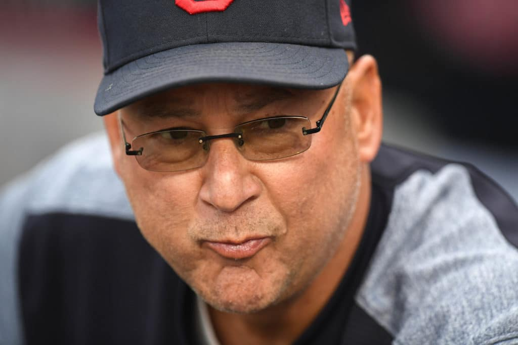 Mar 7, 2018; Goodyear, AZ, USA; Cleveland Indians manager Terry Francona (77) looks on prior to facing the Chicago Cubs at Goodyear Ballpark. Mandatory Credit: Joe Camporeale-USA TODAY Sports