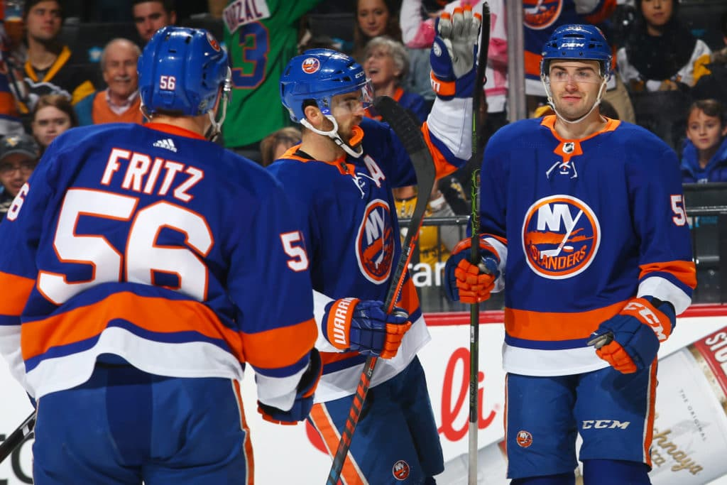 NEW YORK, NY - MARCH 20: Adam Pelech #50 of the New York Islanders celebrates his first period goal with teamates Andrew Ladd #16 and Tanner Fritz #56 against the Pittsburgh Penguins at Barclays Center on March 20, 2018 in New York City.  (Photo by Mike Stobe/NHLI via Getty Images)