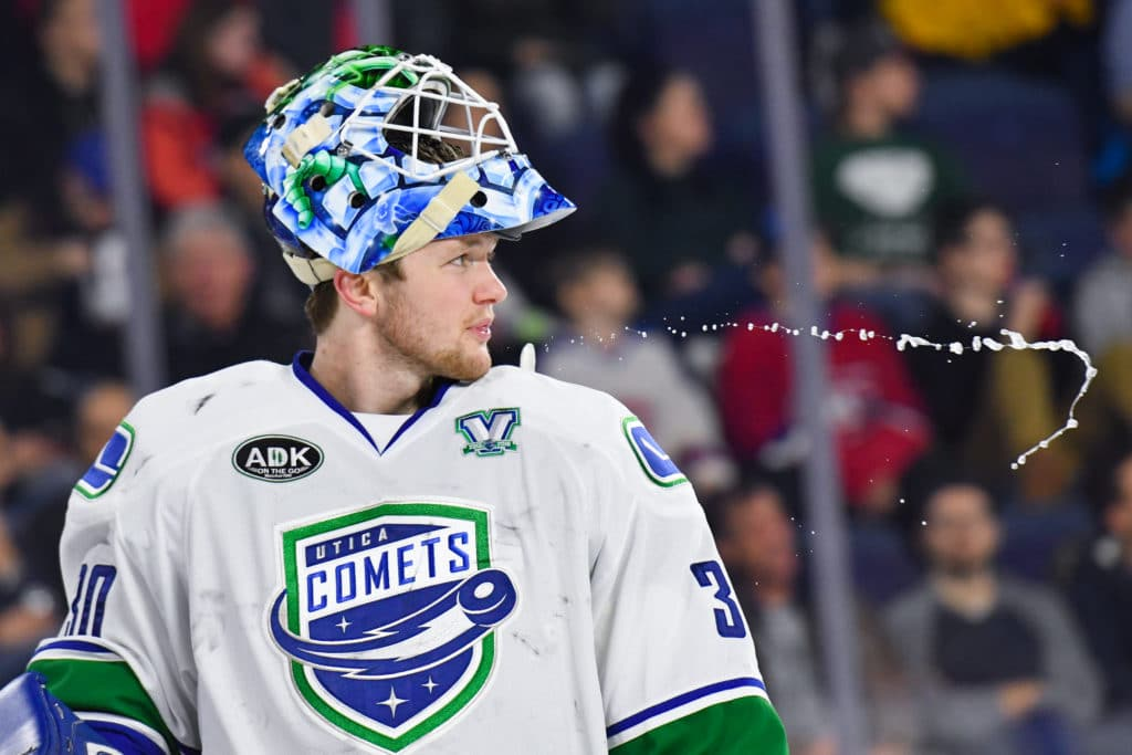 LAVAL, QC - JANUARY 10: Utica Comets goalie Thatcher Demko (30) spits water during the Utica Comets versus the Laval Rocket game on January 10, 2018, at Place Bell in Laval, QC (Photo by David Kirouac/Icon Sportswire via Getty Images)