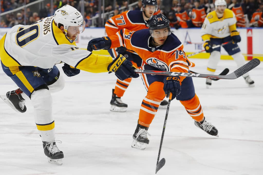 Mar 1, 2018; Edmonton, Alberta, CAN; Edmonton Oilers defensemen Ethan Bear (74) tries to block a shot by Nashville Predators forward Colton Sissons (10) during the second period at Rogers Place. Mandatory Credit: Perry Nelson-USA TODAY Sports