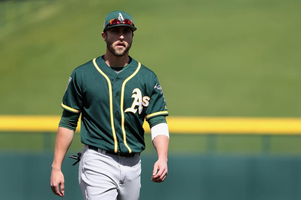 MESA, AZ - FEBRUARY 28:  Dustin Fowler #11 of the Oakland Athletics warms up before the spring training game against the Chicago Cubs at Sloan Park on February 28, 2018 in Mesa, Arizona.  (Photo by Christian Petersen/Getty Images)