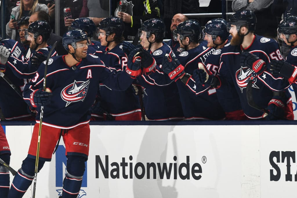 COLUMBUS, OH - MARCH 22: Seth Jones #3 of the Columbus Blue Jackets high-fives his teammates after scoring a goal during the second period of a game against the Florida Panthers on March 22, 2018 at Nationwide Arena in Columbus, Ohio.  (Photo by Jamie Sabau/NHLI via Getty Images)