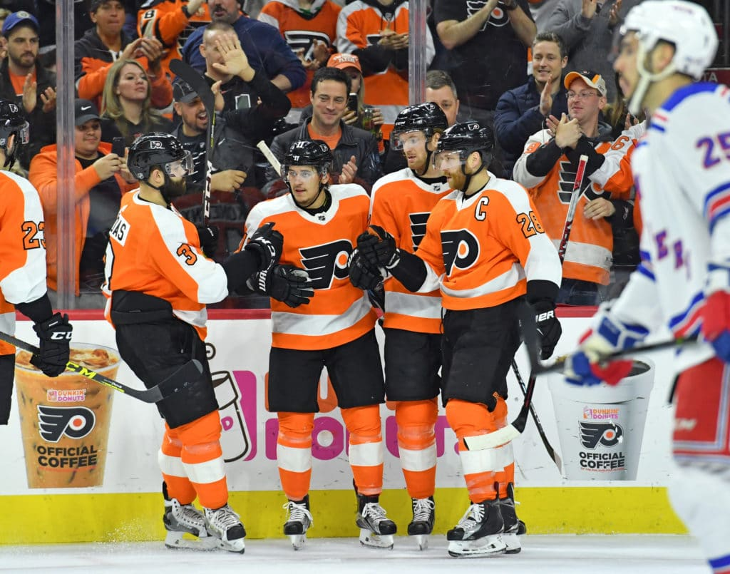 Mar 22, 2018; Philadelphia, PA, USA; Philadelphia Flyers center Travis Konecny (11) celebrates with teammates after scoring a goal  against the New York Rangers during the second period at Wells Fargo Center. Mandatory Credit: Eric Hartline-USA TODAY Sports