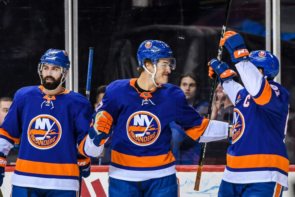 Mar 22, 2018; Brooklyn, NY, USA; New York Islanders left wing Anders Lee (27) celebrates with center John Tavares (91) and defenseman Nick Leddy (2) after scoring a goal against the Tampa Bay Lightning during the second period at Barclays Center. Mandatory Credit: Dennis Schneidler-USA TODAY Sports