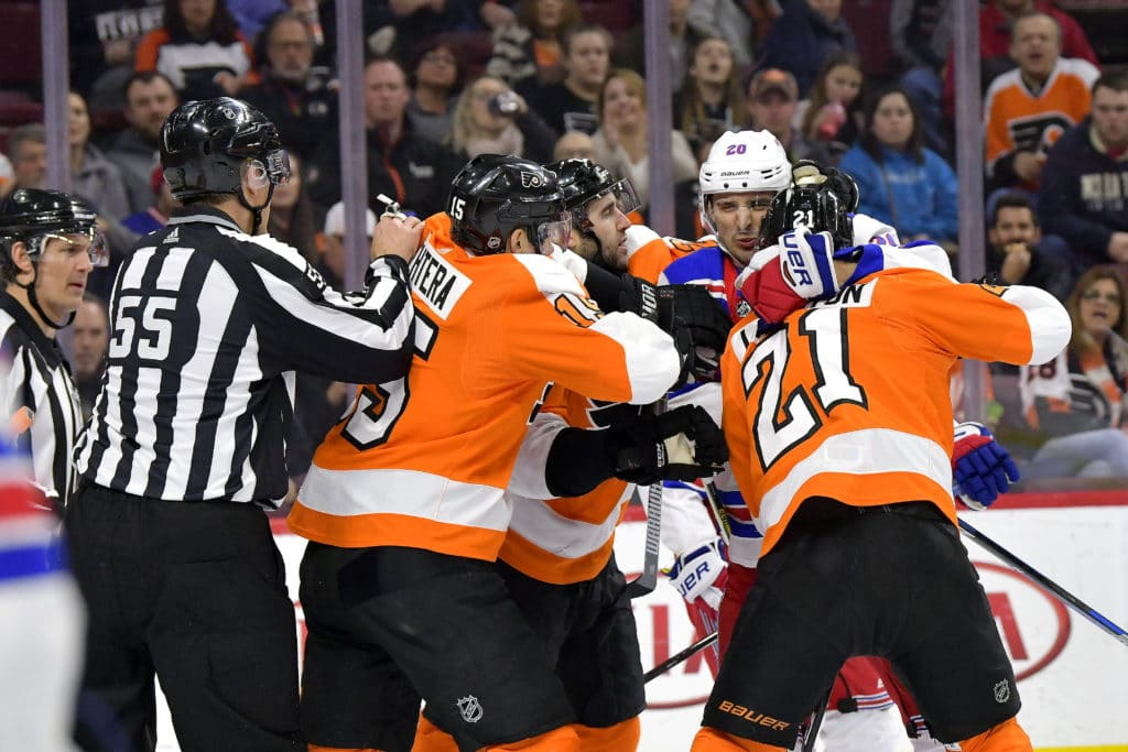 PHILADELPHIA, PA - MARCH 22: New York Rangers left wing Chris Kreider (20) Philadelphia Flyers center Scott Laughton (21), and Philadelphia Flyers center Jori Lehtera (15) get physical during the NHL game between the New York Rangers and the Philadelphia Flyers on March 22, 2018 at the Wells Fargo Center in Philadelphia PA. (Photo by Gavin Baker/Icon Sportswire via Getty Images)