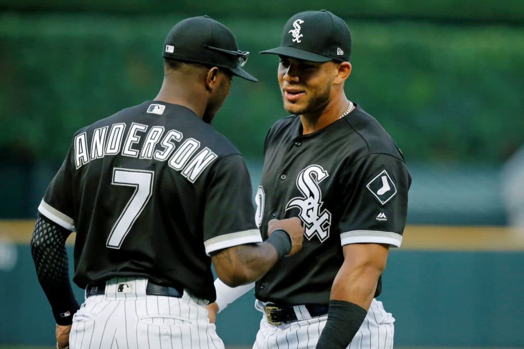 CHICAGO, IL - JULY 26: Tim Anderson #7 of the Chicago White Sox and Yoan Moncada #10 talk while warming up before the game against the Chicago Cubs at Guaranteed Rate Field on July 26, 2017 in Chicago, Illinois. The Chicago Cubs won 8-3.  (Photo by Jon Durr/Getty Images)