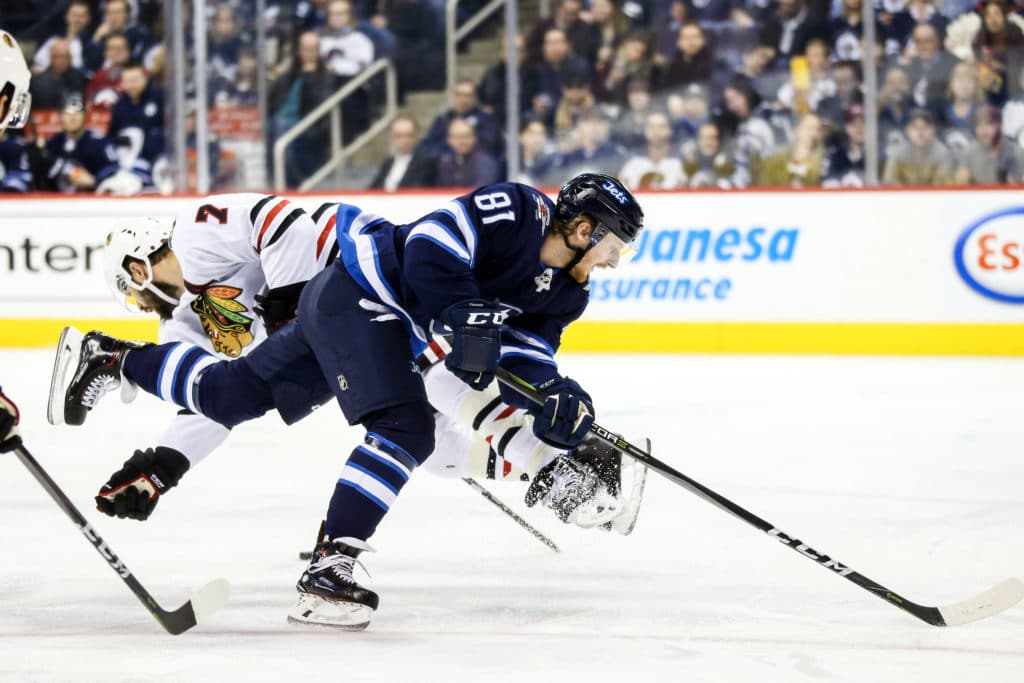 Mar 15, 2018; Winnipeg, Manitoba, CAN; Winnipeg Jets forward Kyle Connor (81) collides with Chicago Blackhawks defenseman Brent Seabrook (7) during the second period at Bell MTS Place. Mandatory Credit: Terrence Lee-USA TODAY Sports