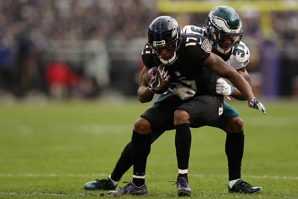 BALTIMORE, MD - DECEMBER 18: Wide receiver Mike Wallace #17 of the Baltimore Ravens is tackled by cornerback Jalen Mills #31 of the Philadelphia Eagles in the first quarter at M&T Bank Stadium on December 18, 2016 in Baltimore, Maryland. (Photo by Patrick Smith/Getty Images)