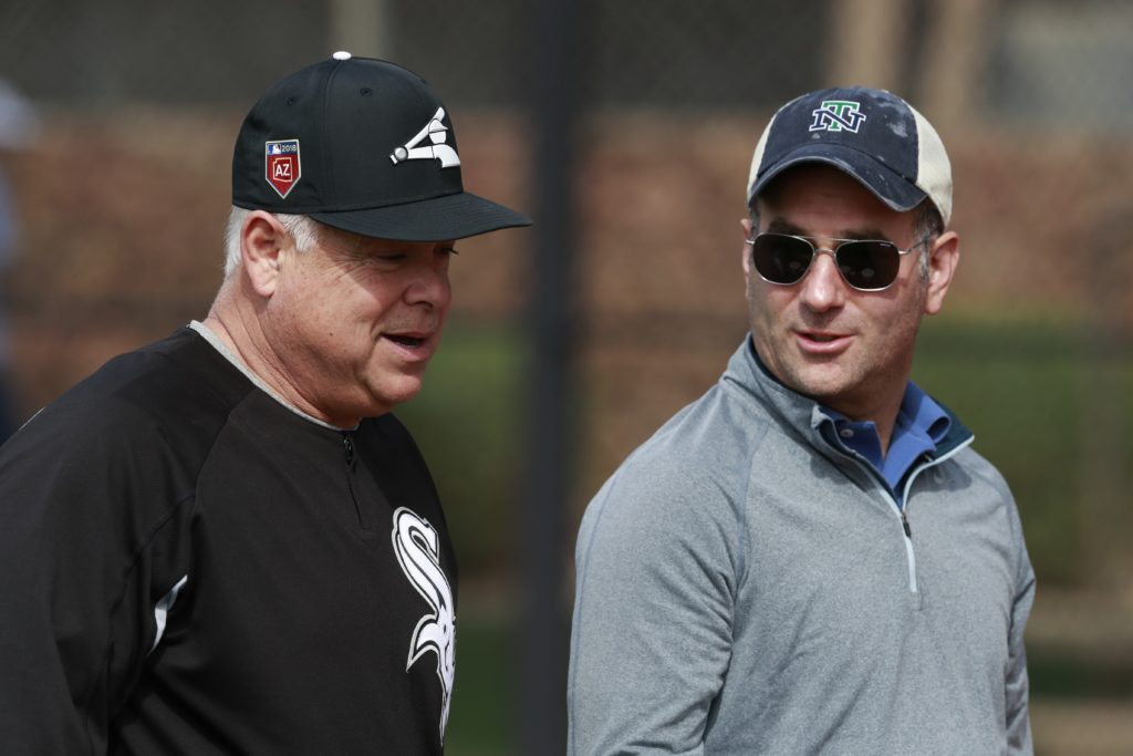 Chicago White Sox manager Rick Renteria, left, walks with Generam Manager Rick Hahn at the team's spring training baseball facility Saturday, Feb. 17, 2018, in Glendale, Ariz. (AP Photo/Carlos Osorio)