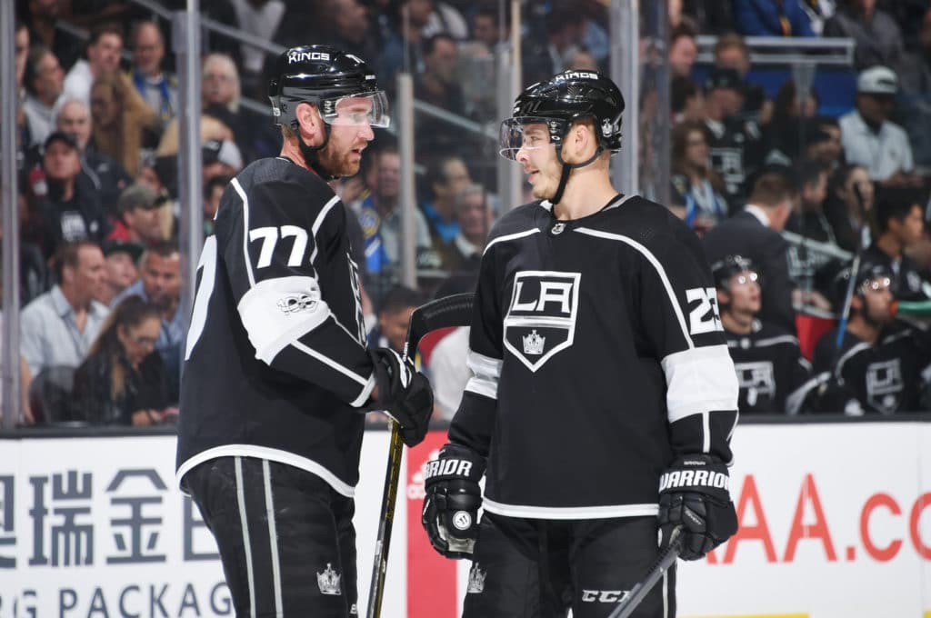 LOS ANGELES, CA - OCTOBER 11:  Jeff Carter #77 and Dustin Brown #23 of the Los Angeles Kings converse during a game against the Calgary Flames at STAPLES Center on October 11, 2017 in Los Angeles, California. (Photo by Adam Pantozzi/NHLI via Getty Images) *** Local Caption ***