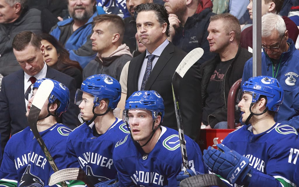 """VANCOUVER, BC - MARCH 17: Head coach Travis Green of the Vancouver Canucks looks on from the bench during their NHL game against the San Jose Sharks at Rogers Arena March 17, 2018 in Vancouver, British Columbia, Canada.  (Photo by Jeff Vinnick/NHLI via Getty Images)""""n"""