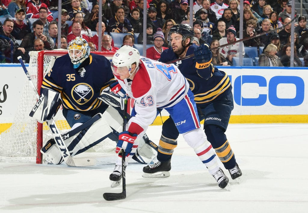 BUFFALO, NY - MARCH 23: Josh Gorges #4 of the Buffalo Sabres battles for position with Daniel Carr #43 of the Montreal Canadiens in front of Linus Ullmark #35 during an NHL game on March 23, 2018 at KeyBank Center in Buffalo, New York. (Photo by Gary Wiepert/NHLI via Getty Images)
