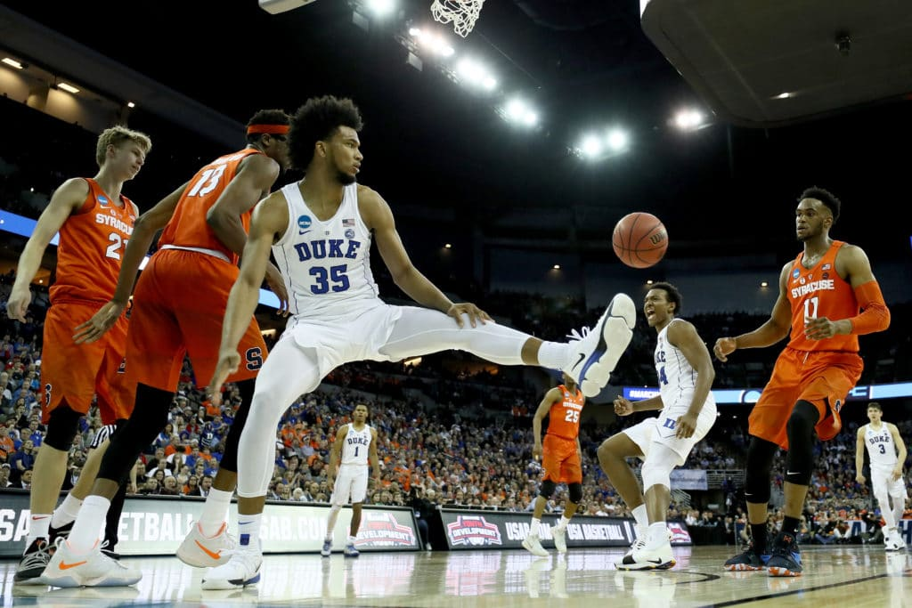 NCAA Tournament: Kansas holds off Clemson; Villanova victorious